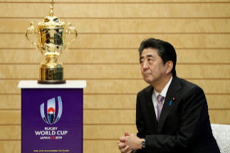 Japan's Prime Minister <HIT>Shinzo</HIT> <HIT>Abe</HIT> looks at the Webb Ellis Trophy during a courtesy call by World Rugby officials as part of the Webb Ellis Trophy tour, at <HIT>Abe</HIT>'s official residence in Tokyo on September 12, 2019, ahead of the start of the 2019 Rugby World Cup on September 20. (Photo by ISSEI KATO / POOL / AFP)