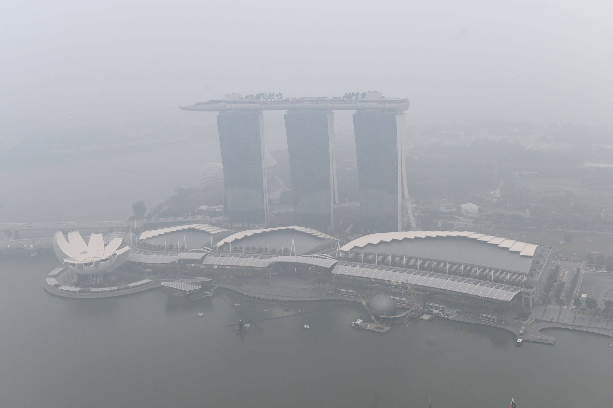 TOPSHOT - This overview shows the Marina Bay Sands hotel and resort blanketed by haze in <HIT>Singapore</HIT> on September 18, 2019. - Toxic haze from Indonesian forest fires closed thousands of schools across the country and in neighbouring Malaysia on September 18, while air quality worsened in <HIT>Singapore</HIT> just days before the city's Formula One motor race. (Photo by Roslan RAHMAN / AFP)