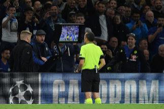 Turkish referee Cuneyt Cakir checks a <HIT>VAR</HIT> replay to award a...
