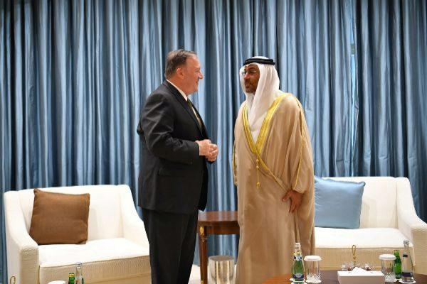 U.S. Secretary of State Mike Pompeo talks to United Arab...
