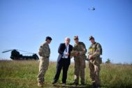 Britain's Prime Minister <HIT>Boris</HIT> Johnson flies a Black Hornet nano drone during a meeting with military personnel on Salisbury plain training area near Salisbury