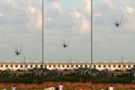 (COMBO) This combination of pictures taken and created on September 7, 2018 shows an Israeli army <HIT>drone</HIT> falling after being covered by a net thrown at it by Palestinian protester during clashes following a demonstration along the Israel-Gaza border, east of Gaza City in the central Gaza Strip. - (Photos by Said KHATIB / AFP)****Silvia, inter