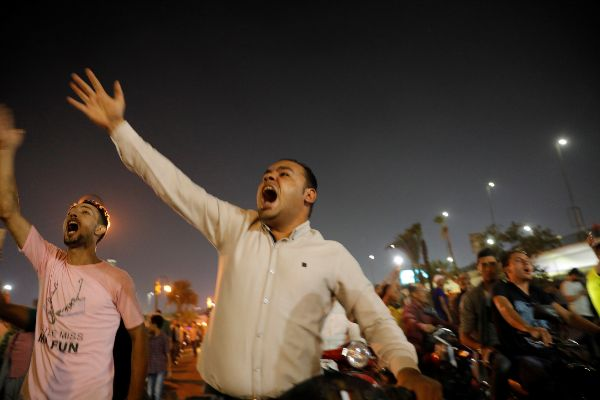 Small groups of protesters gather in central <HIT>Cairo</HIT> shouting...