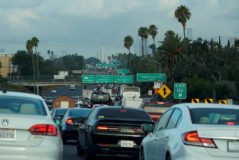 FILE PHOTO: Morning traffic makes its way along a Los Angeles freeway in Los Angeles