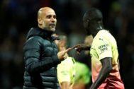 Guardiola, con Mendy.