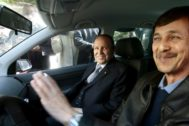 FILE PHOTO: <HIT>Algeria</HIT>'s President Abdelaziz Bouteflika smiles as he arrives with his brother Said at his campaign's communications department during a surprise visit in Algiers