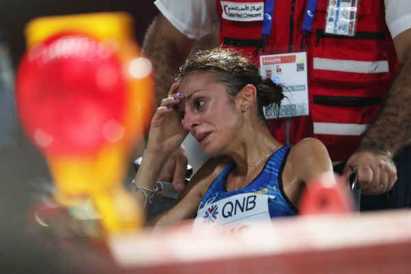 Doha (Qatar).- Giovanna Epis of Italy receives medical attention...