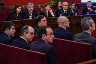 Jordi Sánchez, ex presidente de ANC; Jordi Turull, ex consejero de Presidencia; Josep Rull, ex consejero de Territorio y Sostenibilidad, de izda. a dcha. en el primer banco, en el juicio del 1-O en el Tribunal Supremo