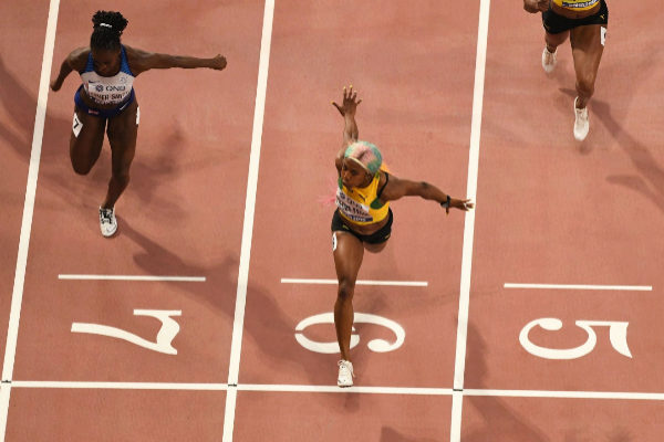 Jamaica&apos;s Shelly-Ann Fraser-Pryce wins the Women&apos;s <HIT>100</HIT>m...