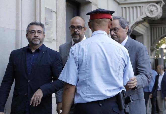 De izqda. a dcha., Andreu Martínez,  Miquel Buch y Quim Torra, en la...