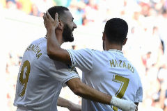Real Madrid's French forward Karim Benzema (L) celebrates scoring the opening goal with Real Madrid's Belgian forward Eden <HIT>Hazard</HIT> during the Spanish league football match between Real Madrid CF and Granada FC at the Santiago Bernabeu stadium in Madrid on October 5, 2019. (Photo by PIERRE-PHILIPPE MARCOU / AFP)