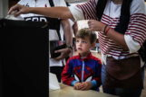 Lisbon (<HIT>Portugal</HIT>).- A child looks on as her mother casts her vote in the legislative elections, in Lisbon, <HIT>Portugal</HIT>, 06 October 2019. More than 10.8 million registered voters are called on the day to the polls to elect the 230 deputies for the next legislature and from where the Constitutional Government will take place. (Elecciones, Lisboa) EPA/