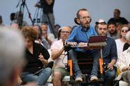 El secretario de Acción de Gobierno, Acción Institucional y Programa de Podemos, Pablo Echenique, interviene durante un acto de precampaña del partido en Madrid
