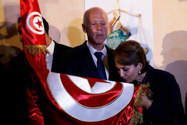 Tunisian presidential candidate Kais Saied and his wife Ichraf Chebil...