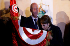 Tunisian presidential candidate Kais Saied and his wife Ichraf Chebil react after exit poll results were announced in a second round runoff of the presidential election in Tunis