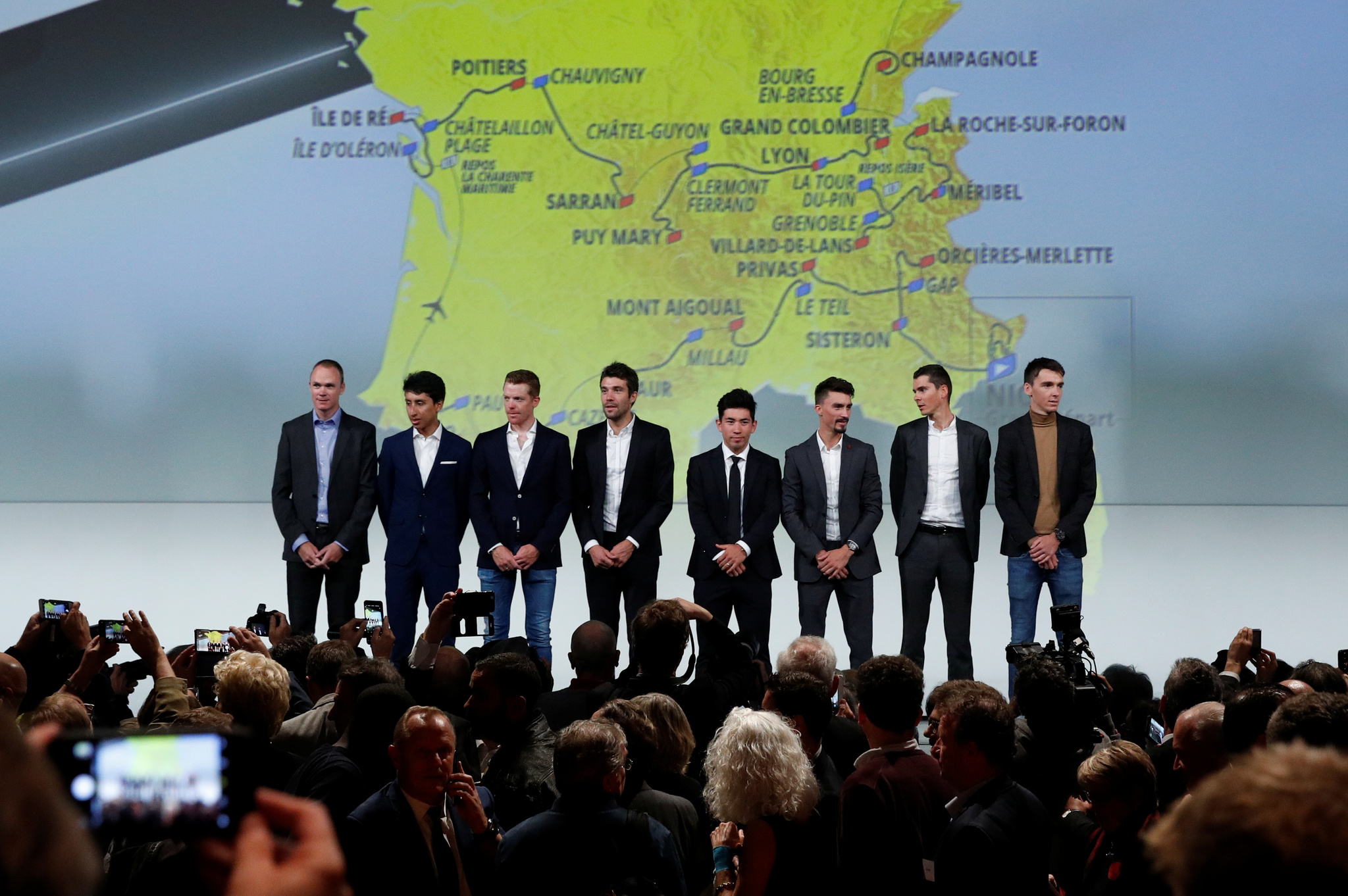 Cyclists pose in front of the map of the 2020 <HIT>Tour</HIT> de...