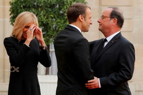 French President Emmanuel Macron and his wife Brigitte Macron welcome ...