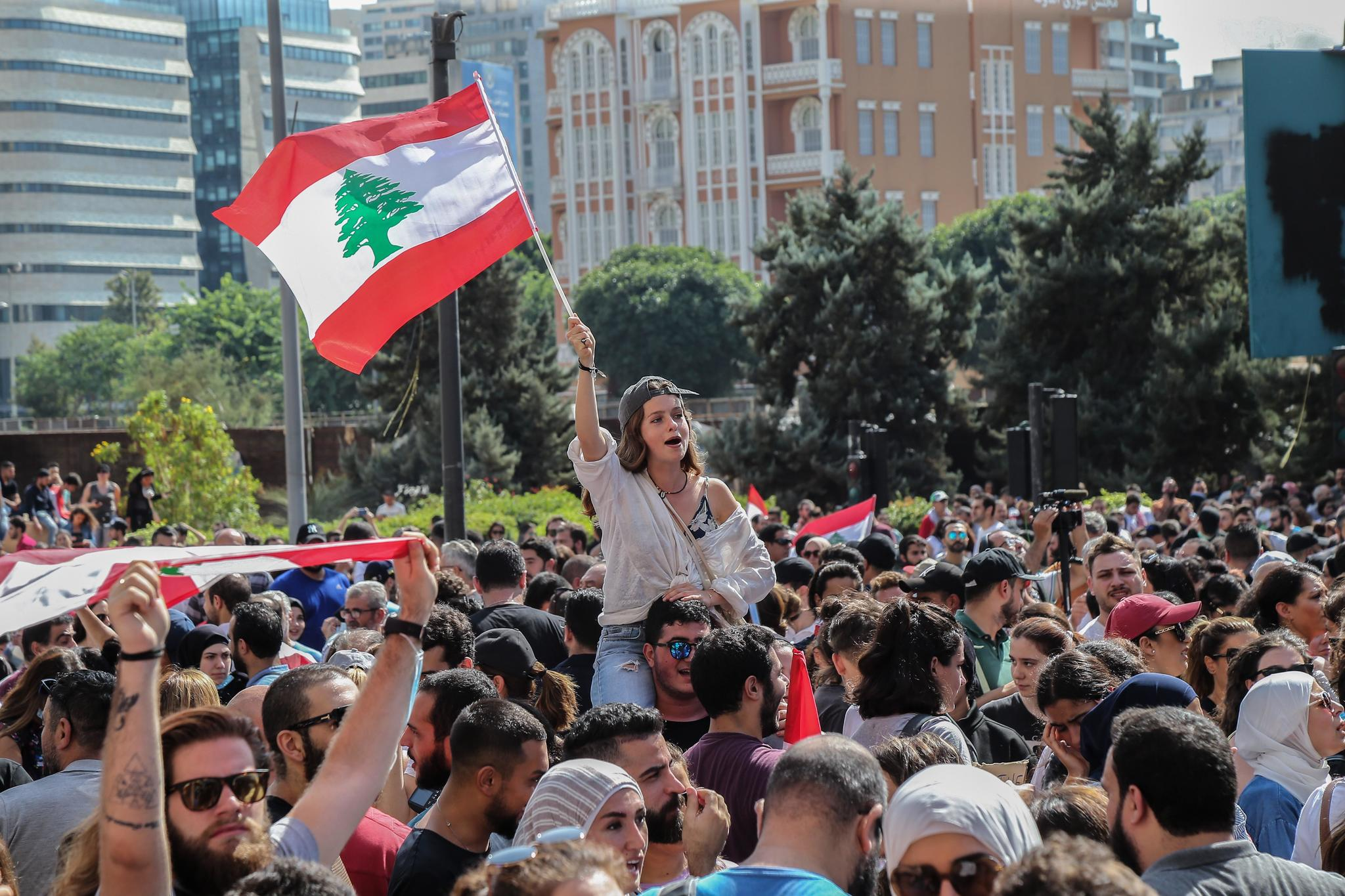 Beirut (<HIT>Lebanon</HIT>).- Protesters carry Lebanese flags and...
