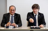 El presidente catalán, Quim Torra (izqda.), y el ex presidente Carles Puigdemont, en un acto, en septiembre, en Bruselas.