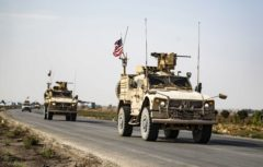 US military vehicleS drive on a road after US forces pulled out of their base in the Northern Syriain town of Tal Tamr on October 20, 2019. - US forces withdrew from a key base in northern Syria today, a monitor said, two days before the end of a US-brokered truce to stem a Turkish attack on Kurdish forces in the region. (Photo by Delil SOULEIMAN / AFP)