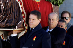 SAN LORENZO DE EL ESCORIA, SPAIN OCTOBER 24: Family members <HIT>Luis</HIT> <HIT>Alfonso</HIT> de Borbón, Francis Franco and Jaime Martínez-Bordiú carry the coffin of Francisco Franco out of the basilica of the Valley of the Fallen mausoleum during the exhumation of the Spanish dictator on October 24, 2019 in San Lorenzo de El Escorial, Spain. Francisco Franco, Spain's fascist dictator, who died in 1975, is being exhumed from his purpose-built mausoleum, the Valley of the Fallen. His remains are being transferred to the crypt in Mingorrubio state cemetery where his wife is buried. (Photo by Juan Carlos Hidalgo Pool/Getty Images)