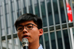 Pro-democracy activist <HIT>Joshua</HIT> <HIT>Wong</HIT> speaks to journalists after being disqualified from running in the local district's council elections in November, in Hong Kong