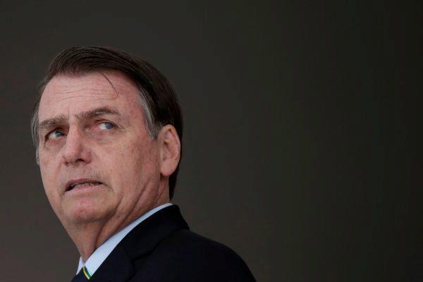 Brazil&apos;s President Jair <HIT>Bolsonaro</HIT> waits for Paraguay&apos;s...