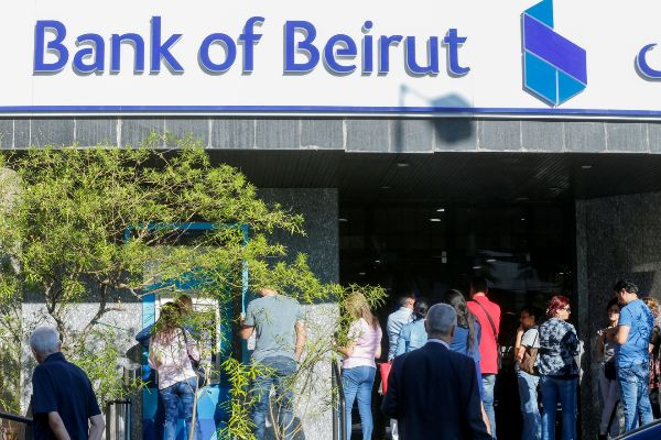 People queue outside a branch of Bank of Beirut in Ain el-Remmaneh