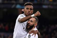 Real Madrid's French forward Karim Benzema (R) celebrates with Real Madrid's Brazilian forward <HIT>Rodrygo</HIT> after scoring during the UEFA Champions League Group A football match between Real Madrid and Galatasaray at the Santiago Bernabeu stadium in Madrid, on November 6, 2019. (Photo by PIERRE-PHILIPPE MARCOU / AFP)