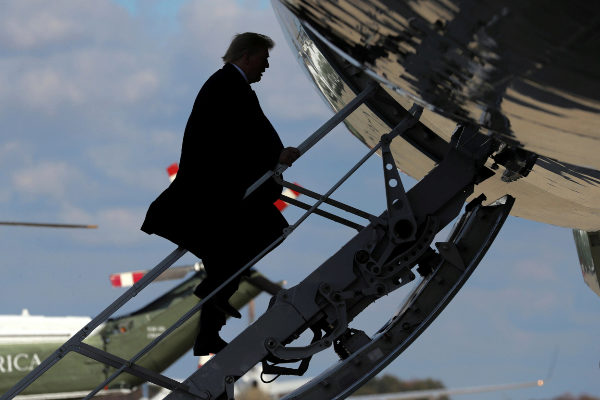 U.S. President <HIT>Trump</HIT> boards Air Force One for travel to...