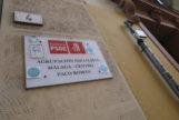 Cartel que identifica la sede del PSOE en la calle Ollerías de Málaga.