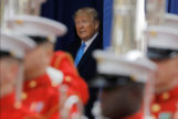 U.S. President Donald <HIT>Trump</HIT> arrives at a Veterans Day Parade and Wreath Laying ceremony in Manhattan, New York City
