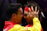 Spain's Rafael <HIT>Nadal</HIT> (R) celebrates with Spain's Roberto <HIT>Bautista</HIT> Agut after defeating Canada's Denis Shapovalov during the final singles tennis match between Canada and Spain at the Davis Cup Madrid Finals 2019 in Madrid on November 24, 2019. (Photo by GABRIEL BOUYS / AFP)