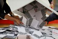 Officials open a ballot box at a polling station in Kowloon Tong, <HIT>Hong</HIT> <HIT>Kong</HIT>
