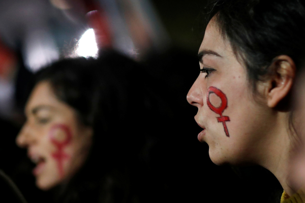 Women participate in a demonstration to protest femicides and...