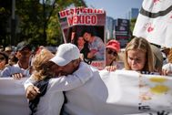 Members of the LeBaron family, part of the Mexican-American <HIT>Mormon</HIT> community who saw nine of its members murdered in November, react during a march to protest against violence on the first anniversary of President Andres Manuel Lopez Obrador taking office