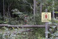 Un cartel advierte del final del territorio de Estonia en su frontera con Rusia.