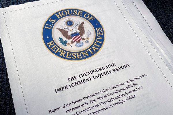 The Trump-Ukraine Impeachment Inquiry Report is seen after release by...