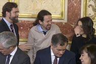 Espinosa de los Monteros, Pablo Iglesias e Inés Arrimadas ríen durante la celebración del día de la Constitutición.