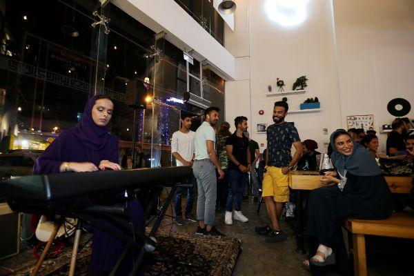 FILE PHOTO: <HIT>Saudi</HIT> female musician, Lojain Sami, plays piano...