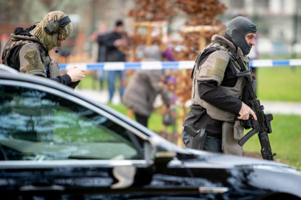 Police officers are seen near the site of a shooting in...