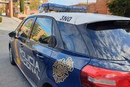 Un coche de la Policía Nacional durarnte una intervención.