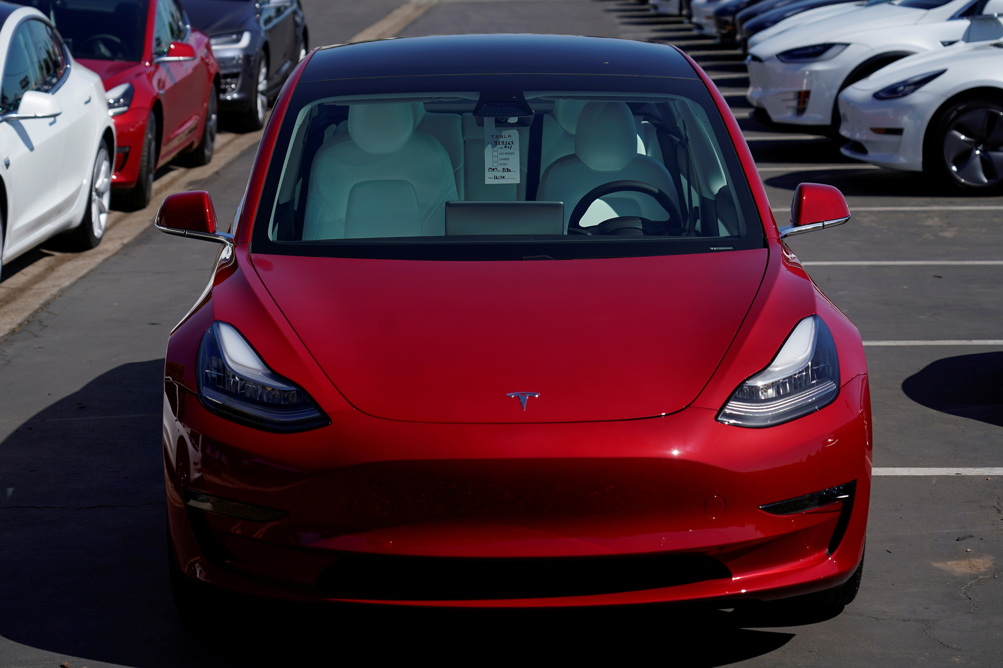 FILE PHOTO: A new <HIT>Tesla</HIT> Model 3 is shown at a delivery...