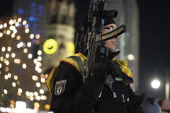<HIT>Berlin</HIT> (Germany).- A policeman with a machine gun stands guard in front of the Kaiser-Wilhelm-Gedaechtniskirche memorial church with the Christmas market on Breitscheidplatz square in <HIT>Berlin</HIT>, Germany, 21 December 2019. A suspicious object was found and the Christmas market evacuated afterwards. In 2016, the place was the target of a terror attack in which 12 people died. (Atentado, Alemania) EPA/