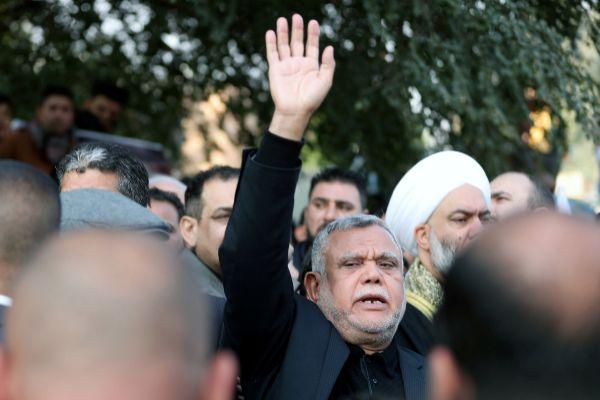 Iraqi militia commander <HIT>Hadi</HIT> al-Amiri reacts as he attends...