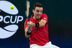 <HIT>Roberto</HIT> <HIT>Bautista</HIT> Agut of Spain hits a return against Aleksandre Metreveli of Georgia in their men's singles match on day two of the ATP Cup tennis tournament in Perth on January 4, 2020. (Photo by TONY ASHBY / AFP) / -- IMAGE RESTRICTED TO EDITORIAL USE - STRICTLY NO COMMERCIAL USE --