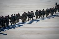 U.S. Army paratroopers assigned to the 1st Brigade Combat Team, 82nd Airborne Division, walk toward an awaiting aircraft prior to departing for the Middle East from Fort Bragg