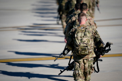 U.S. Army paratroopers assigned to the 1st Brigade Combat Team, 82nd <HIT>Airborne</HIT> Division, walk toward an awaiting aircraft prior to departing for the Middle East from Fort Bragg