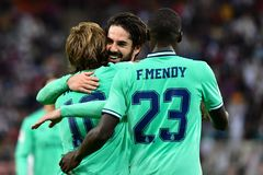 Real Madrid's Croatian midfielder Luka Modric (L) celebrates his goal with Real Madrid's Spanish midfielder Isco (C) and Real Madrid's French defender Ferland Mendy (R) during the Spanish Super Cup semi final between <HIT>Valencia</HIT> and Real Madrid on January 8, 2020, at the King Abdullah Sport City in the Saudi Arabian port city of Jeddah. (Photo by GIUSEPPE CACACE / AFP)
