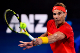 Rafael <HIT>Nadal</HIT> of Spain hits a return his men's singles match against Alex de Minaur of Australia at the ATP Cup tennis tournament in Sydney on January 11, 2020. (Photo by William WEST / AFP) / --IMAGE RESTRICTED TO EDITORIAL USE - NO COMMERCIAL USE--